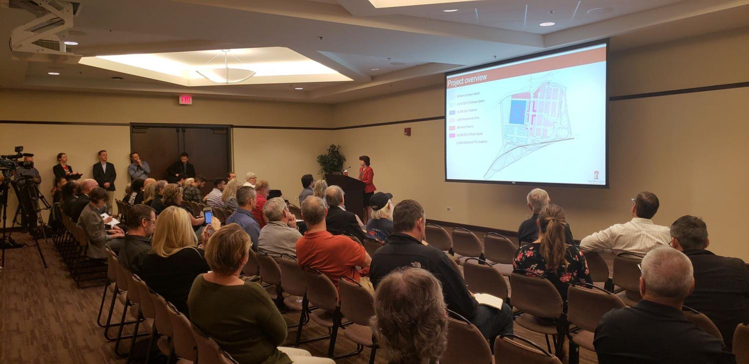 Director of Planning Laura Shinn addresses public at the first Mission Valley scoping meeting in the Parma Payne Goodall Alumni Center on Jan. 29.