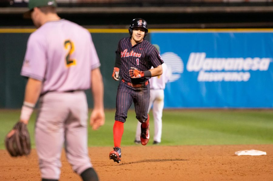 Junior+outfielder+Julian+Escobedo+rounds+the+bases+after+hitting+a+home+run+during+the+Aztecs+8-4+victory+over+USF+on+Feb.+15+at+Tony+Gwynn+Stadium.+Escobedo+finished+with+a+career-high+five+RBI%27s.+