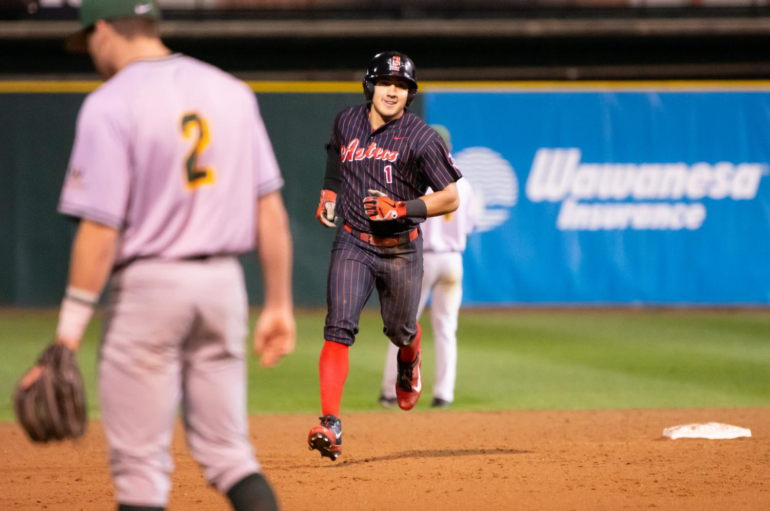 Junior outfielder Julian Escobedo rounds the bases after hitting a home run during the Aztecs 8-4 victory over USF on Feb. 15 at Tony Gwynn Stadium. Escobedo finished with a career-high five RBI's.