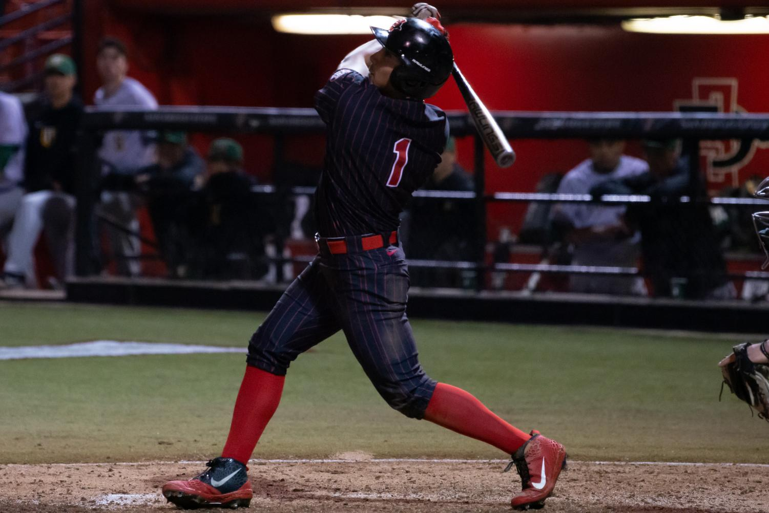 Junior outfielder Julian Escobedo follows through on a swing during the Aztecs 8-4 victory over USF on Feb. 15 at Tony Gwynn Stadium.