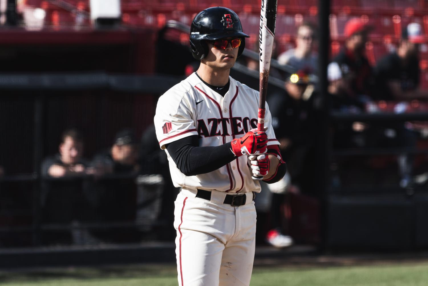 Senior designated hitter Chad Bible prepares to bat during the Aztecs 9-8 loss to San Francisco on Feb. 16 at Tony Gwynn Stadium.