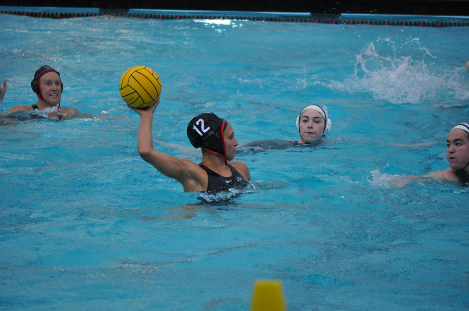 Sophomore driver Dani D'Andrea attempts a shot during the Aztecs' 11-3 victory in an exhibition against Toronto on Feb. 14 at the Aztec Aquaplex.