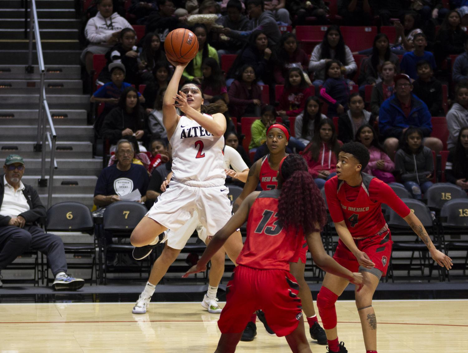 Freshman guard Sophia Ramos lays the ball over the New Mexico defense during the Aztecs' 61-59 victory over the Lobos on Feb. 6 at Viejas Arena.