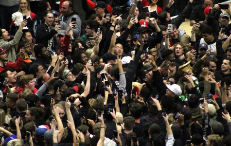 Fans storm the court following Aztecs' 65-57 victory over No. 6 Nevada