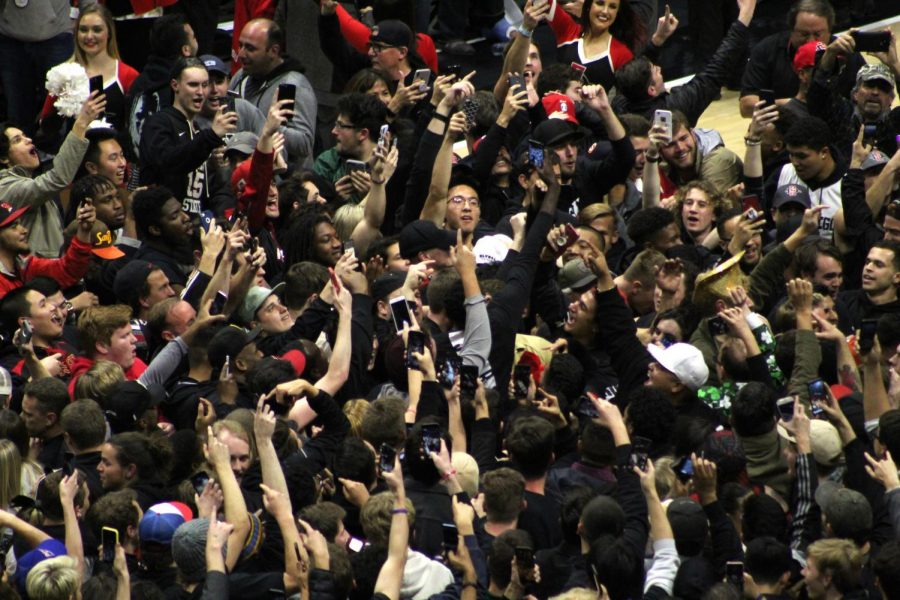 Fans+stormed+the+court+following+the+Aztecs+65-57+victory+over+No.+6+Nevada+on+Feb.+20+at+Viejas+Arena.