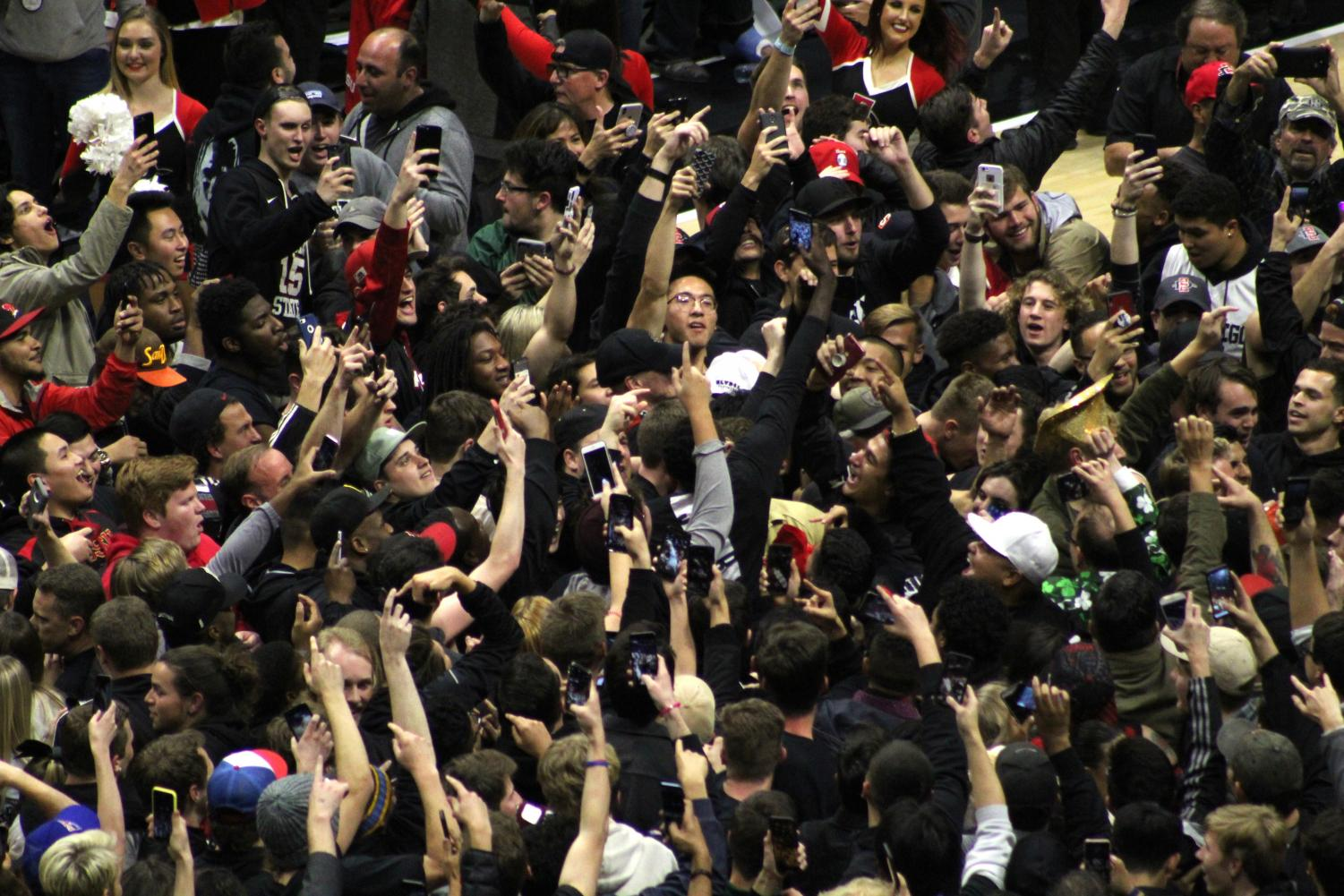 Fans stormed the court following the Aztecs 65-57 victory over No. 6 Nevada on Feb. 20 at Viejas Arena.