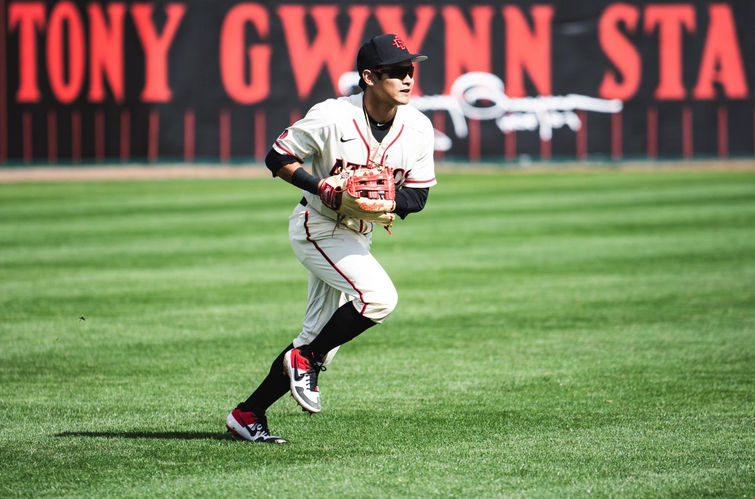 Then-sophomore left fielder Matt Rudick fields a ball in the outfield during the Aztecs 9-8 loss to San Francisco on Feb. 16, 2019 at Tony Gwynn Stadium.