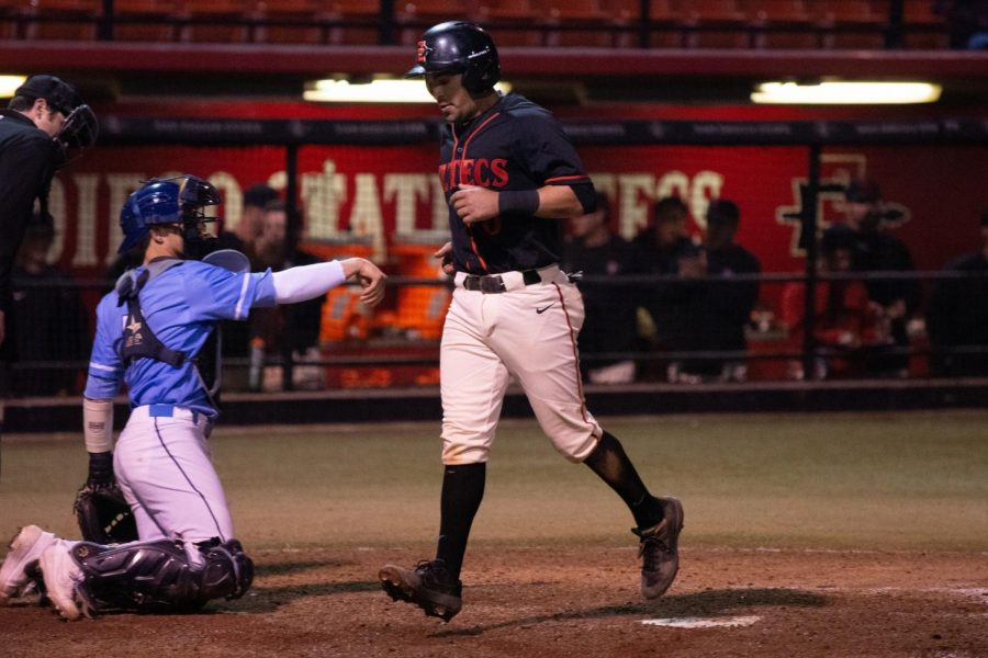 Senior+infielder+Angelo+Armenta+steps+on+home+plate+to+score+a+run+during+the+Aztecs%27+4-2+loss+against+San+Diego+on+Feb.+23+at+Tony+Gwynn+Stadium.