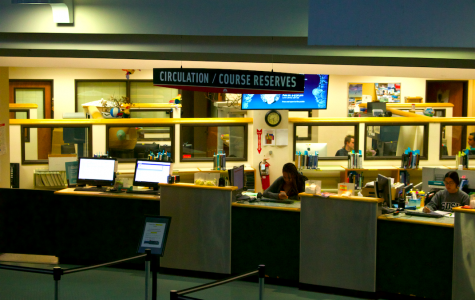 Students can go to the circulation desk at the Malcom A. Love Library to check out textbooks from Course Reserves.
