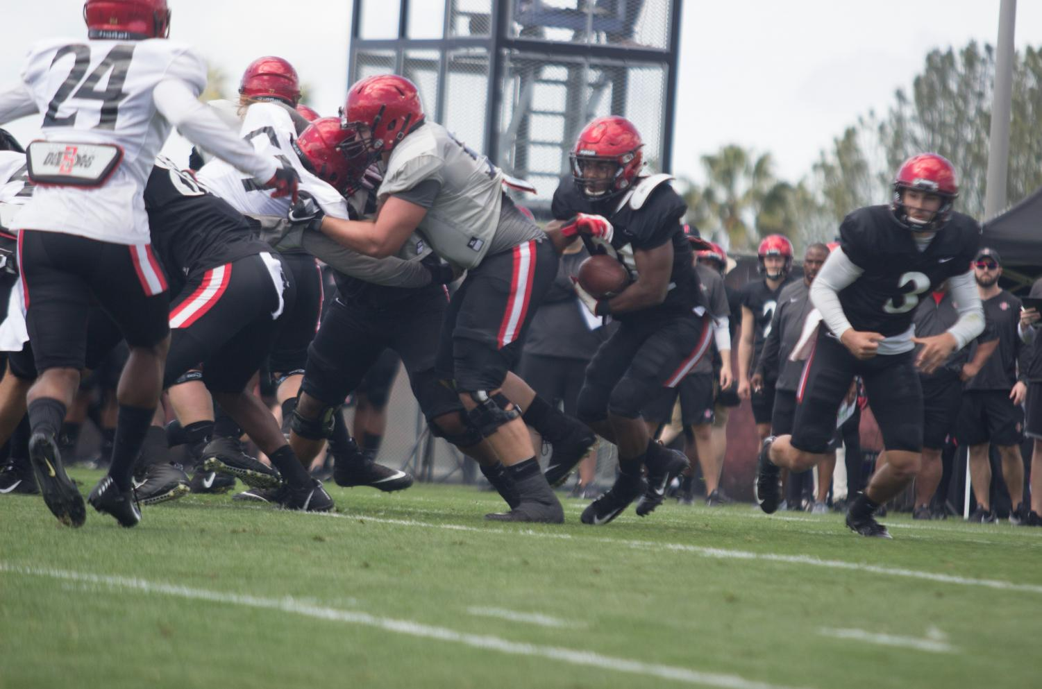 Sophomore running back Chance Bell carries the ball during the Aztecs spring football game on March 23 at the SDSU practice field.