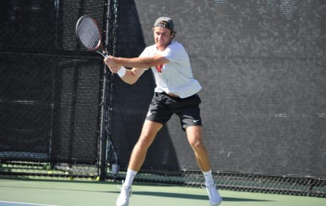 Senior Sander Gjoels-Anderson swings his racket during the Aztecs' 4-1 loss to Harvard on March 22 at the Aztec Tennis Center.