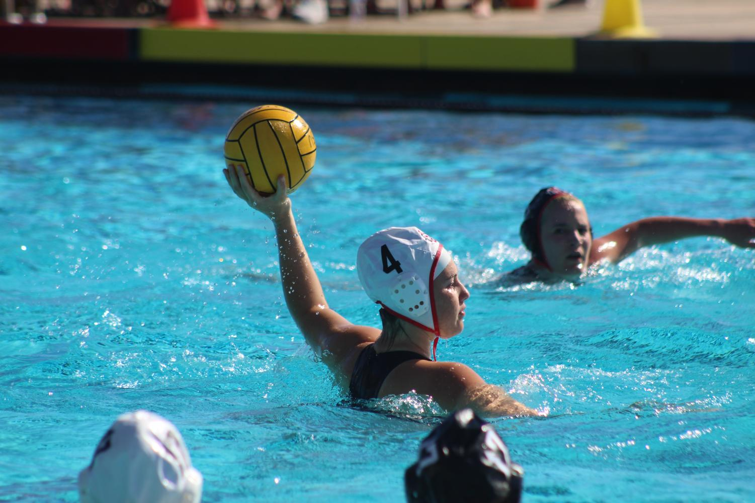 Sophomore utility Maddie Higginson handles the ball during the Aztecs 12-9 loss to the SDSU alumni at the Aztec Aquaplex on Jan. 26.