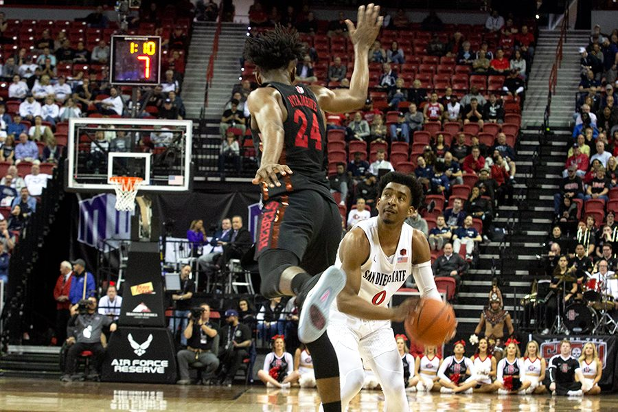 Senior+guard+Devin+Watson+pump+fakes+the+defender+during+the+Aztecs%27+game+against+UNLV+on+March+14.+