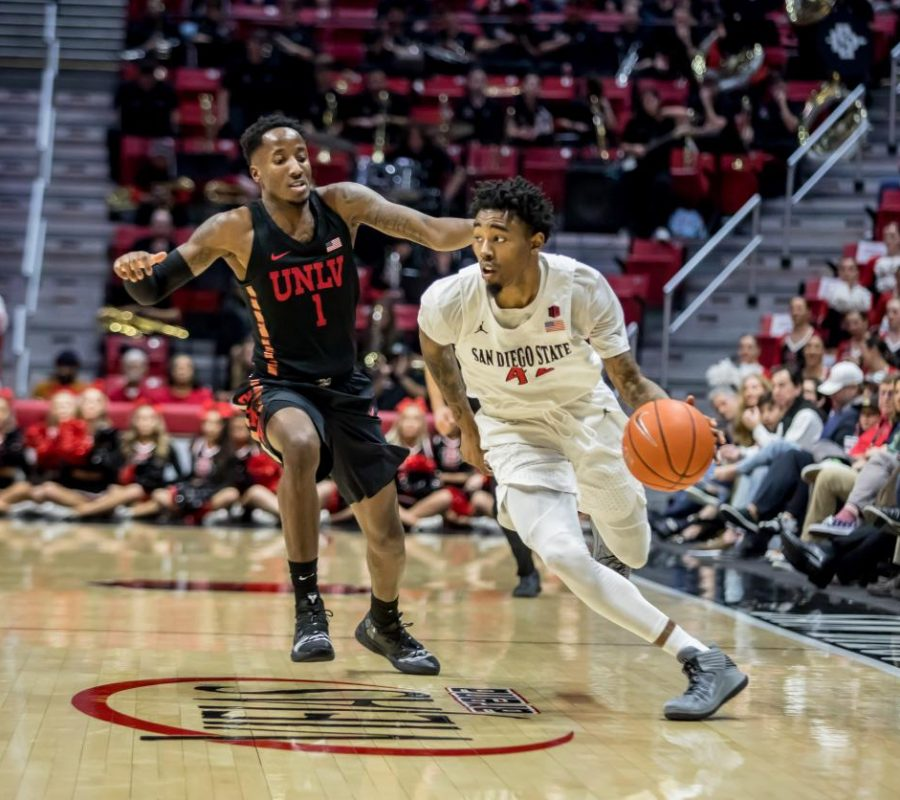 Senior+guard+Jeremy+Hemsley+drives+past+his+defender+during+the+Aztecs%E2%80%99+94-77+victory+over+UNLV+on+Jan.+26+at+Viejas+Arena.