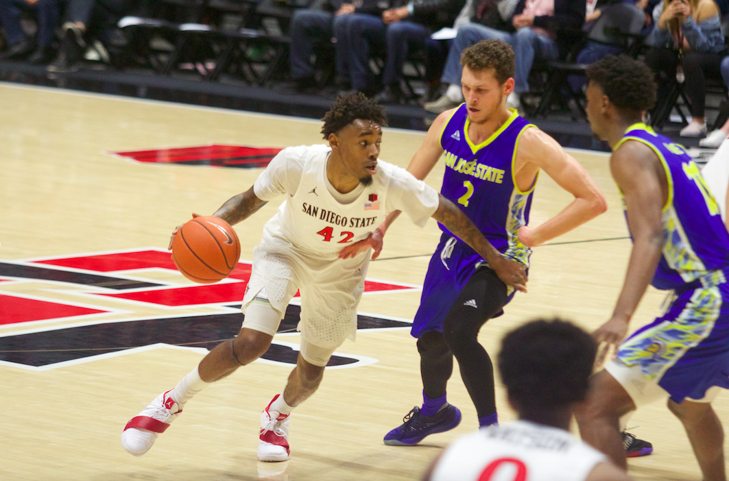 Senior guard Jeremy Hemsley drives past the defense during the Aztecs' 84-56 victory over SJSU on March 2 at Viejas Arena.
