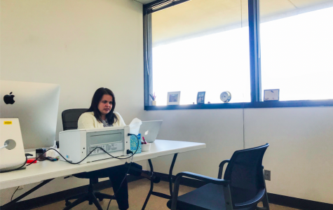 Student Success Specialist for PSFA Renee Rodriguez-Merino works in a temporary office space on the fourth floor of Adams Humanities after dangerous fumes in the PSFA building have deemed the area unsafe for faculty.
