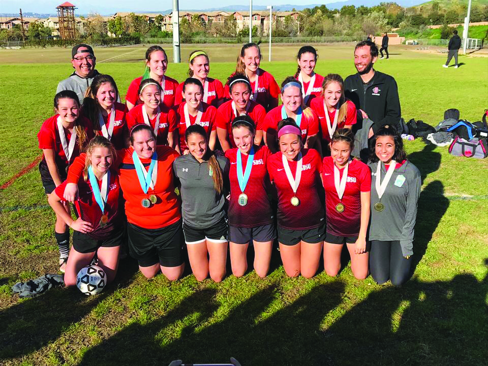 San Diego State women's club soccer celebrates its 3-1 Open Cut National Championship win over Southern California on Feb. 23 at UC Irvine.