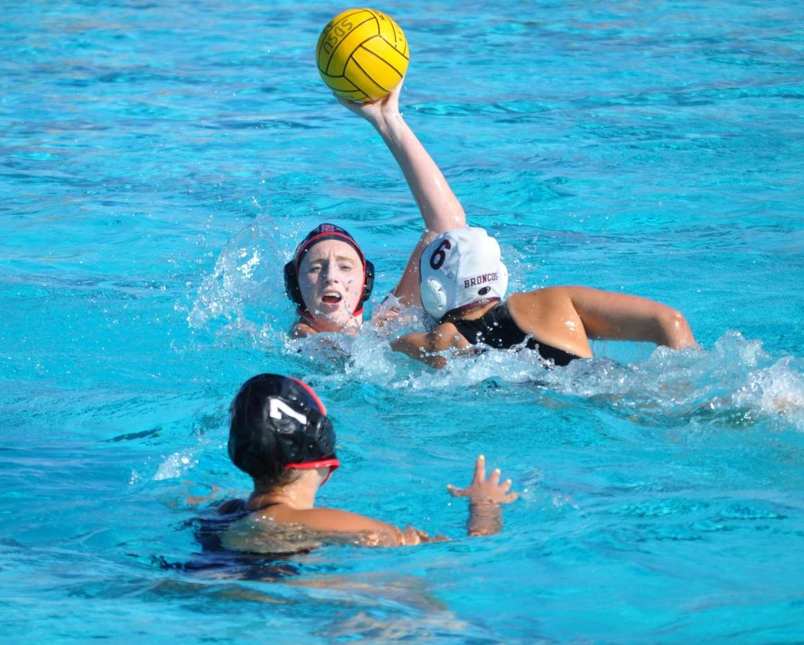 Sophomore utility player Emily Bennett attempts to pass the ball to junior utility player Shelby Kraft during the Aztecs' 4-1 victory over Santa Clara on March 28 at the Aztec Aquaplex.