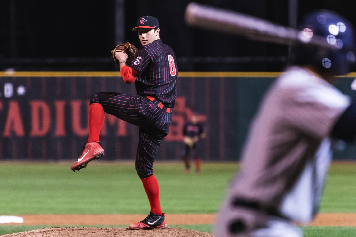 Sophomore pitcher Casey Schmitt pitches during his save against Nevada on March 8 at Tony Gwynn Stadium.