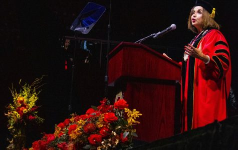 President Adela de la Torre addresses Viejas Arena, filled with university community members, at her inauguration on April 11.
