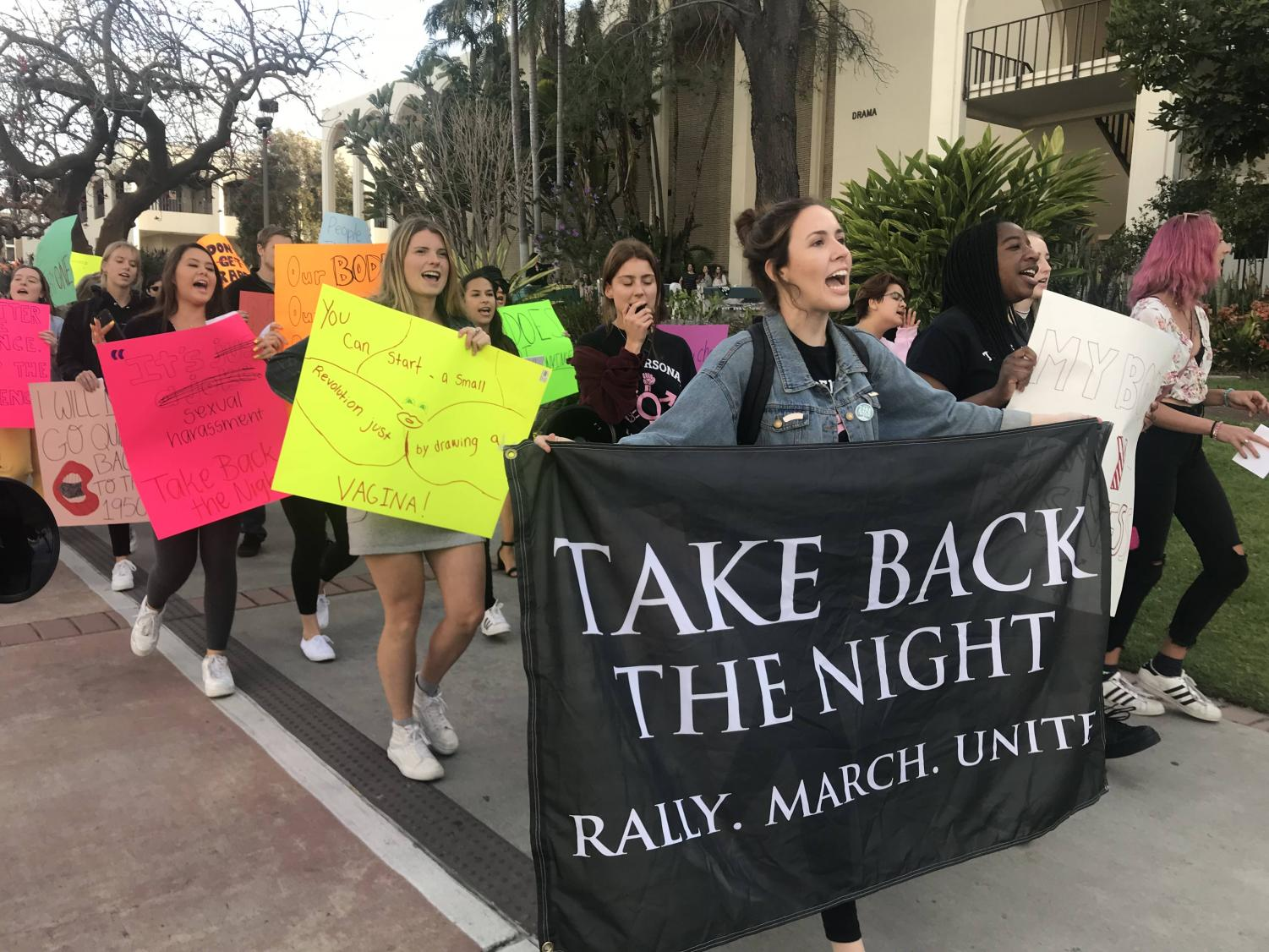 Womyn's Outreach Association President Shelby Rodich led the Take Back the Night march on campus.