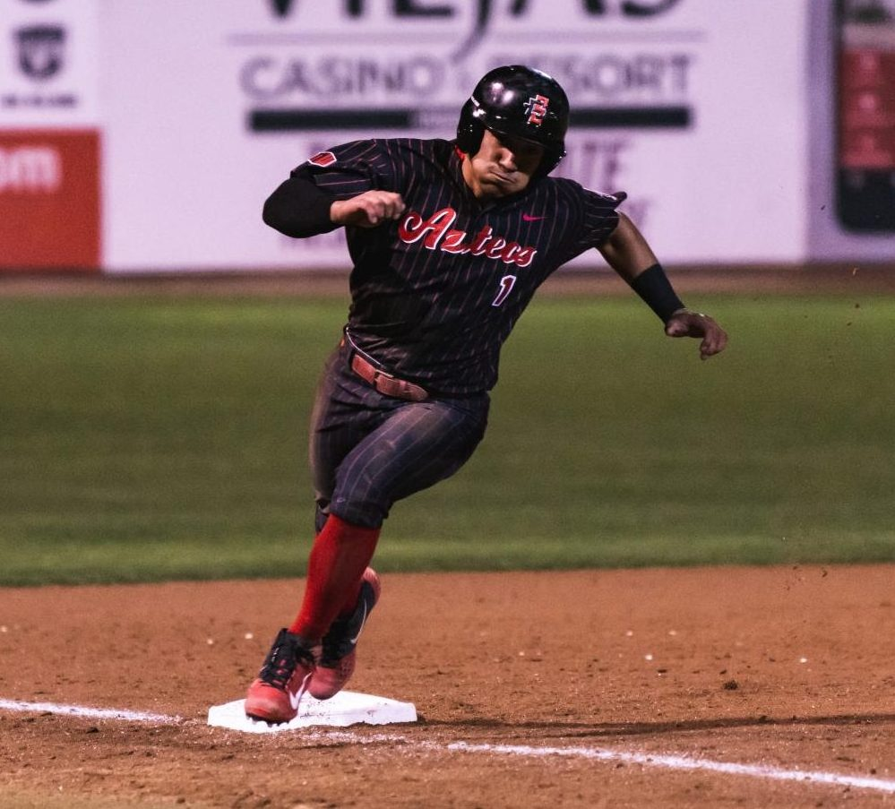 Junior outfielder Julian Escobedo runs past third base during the Aztecs' series against Nevada from March 8-10 at Tony Gwynn Stadium.