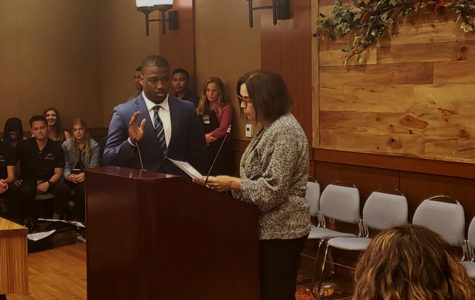 A.S. President-elect Christian Onwuka is sworn into office on May 1 by President Adela de la Torre.