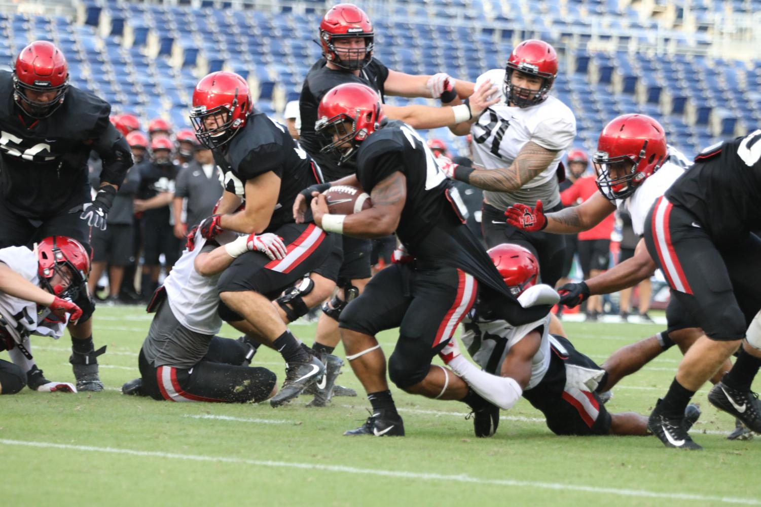 Sophomore running back Kaegun Williams attempts to break a tackle during the Aztecs' scrimmage at the annual Fan Fest on Saturday at SDCCU Stadium.