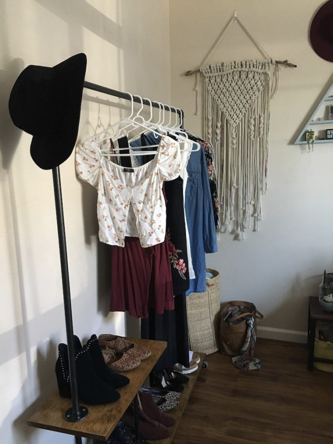 Verhaeghe's rolling closet sits against the far wall in her room.