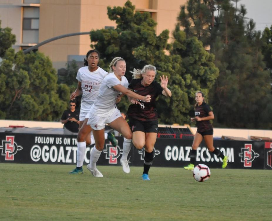 Junior midfielder Chloe Frisch attempts to dribble the ball past a defender during the Aztecs' 5-0 loss to Washington State on Aug. 16 at the SDSU Sports Deck.