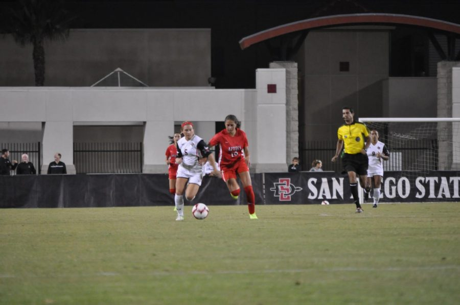 SDSU+freshman+midfielder+Kiera+Utush+fights+for+possession+against+a+Texas+Tech+defender+on+Aug.+22+at+the+SDSU+Sports+Deck.