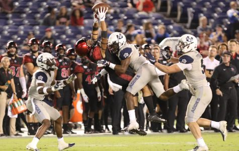 Then-redshirt freshman wide receiver Jesse Matthews catches a pass over Utah State then-sophomore cornerback Andre Grayson in the Aztecs' 23-17 loss to Utah State on Sept. 21, 2019 at SDCCU Stadium.