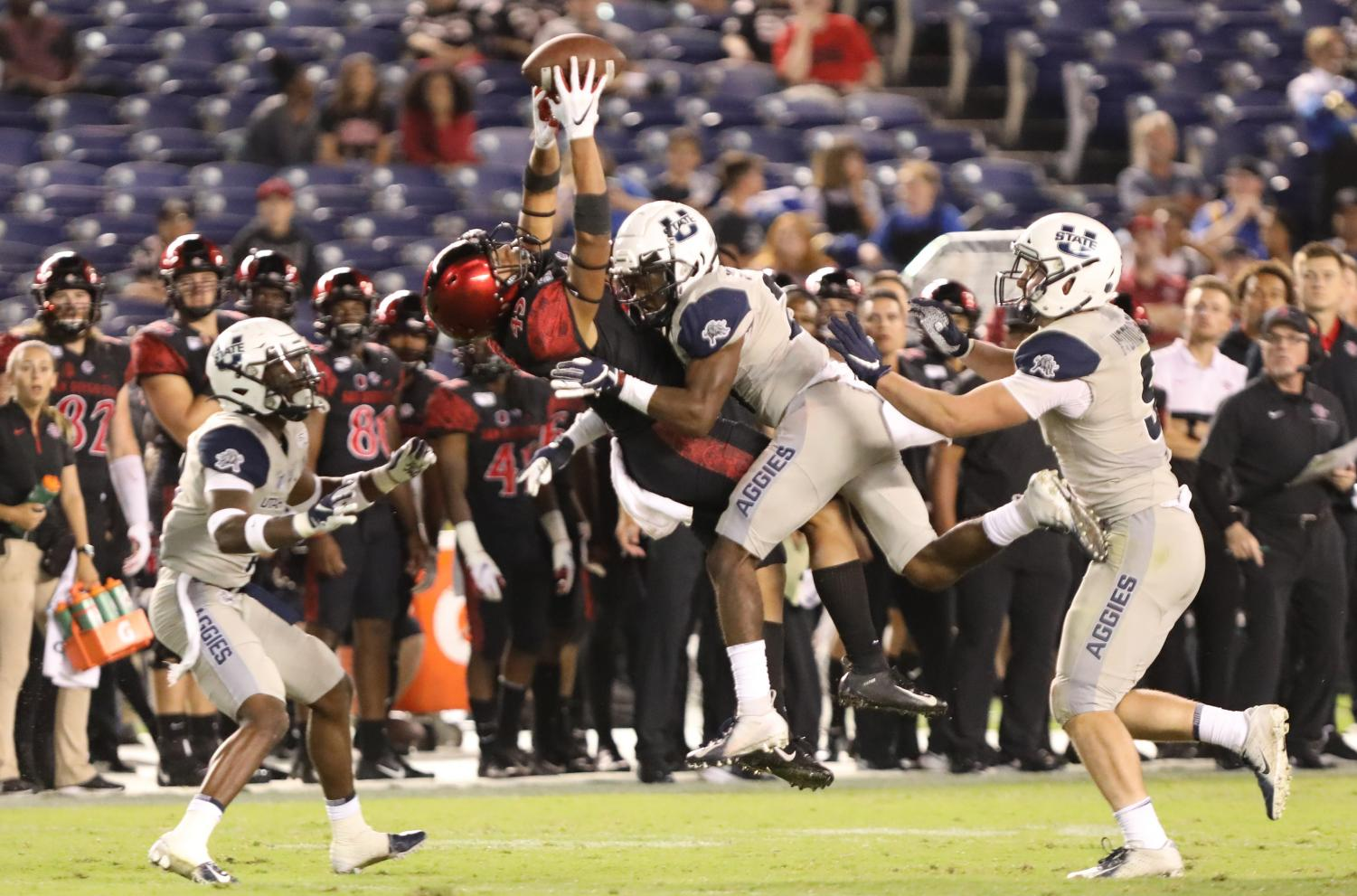 Redshirt freshman wide receiver Jesse Matthews catches a pass over Utah State sophomore cornerback Andre Grayson in the Aztecs' 23-17 loss to Utah State on Sept. 21 at SDCCU Stadium.