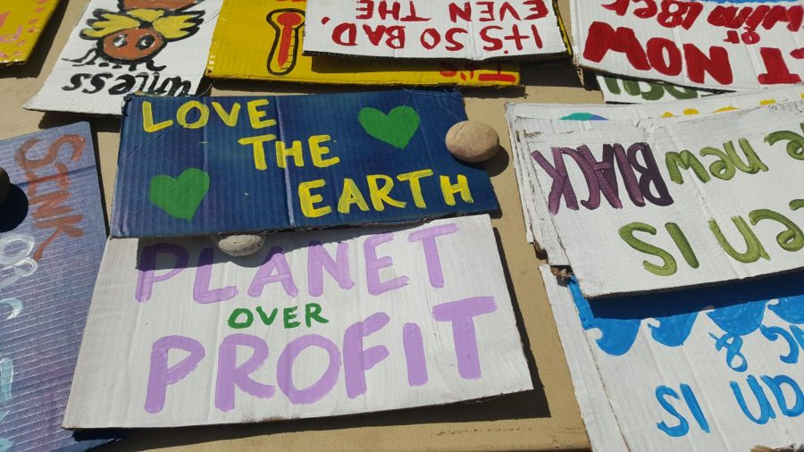 Planet over Profit and other slogans covered the signs students would use for the climate strike.