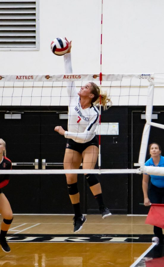 Senior outside hitter Hannah Turnlund spikes the ball during the Aztecs' 3-1 win over Long Beach State on Sept. 19 at Peterson Gym.