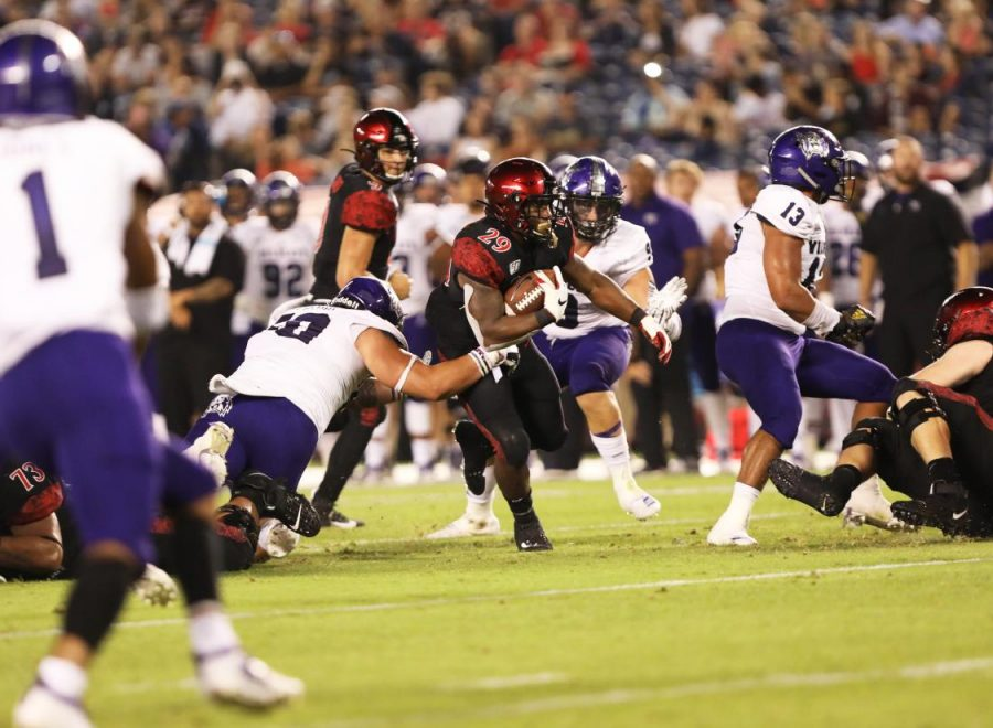 SDSU+senior+running+back+Juwan+Washington+runs+through+the+Wildcats%E2%80%99+defense+during+the+Aztecs%E2%80%99+6-0+victory+on+Aug.+31+at+SDCCU+Stadium.