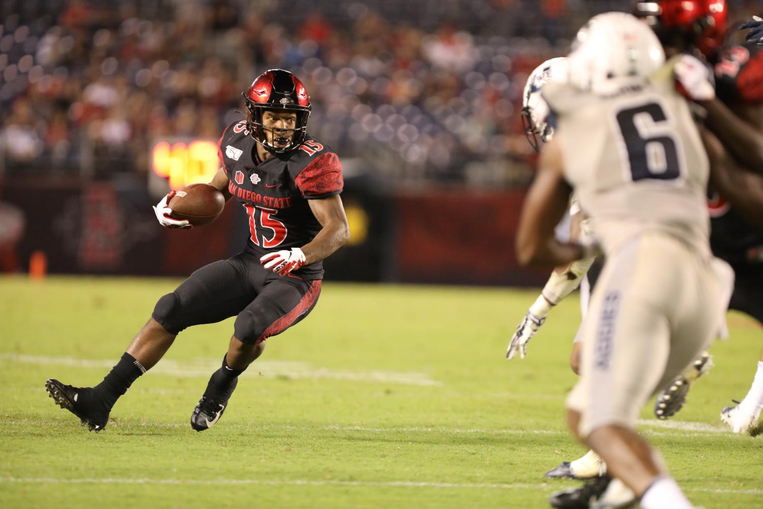 Sophomore running back Jordan Byrd rushes the ball during the Aztecs' 23-17 loss to Utah State on Sept. 21 at SDCCU Stadium.