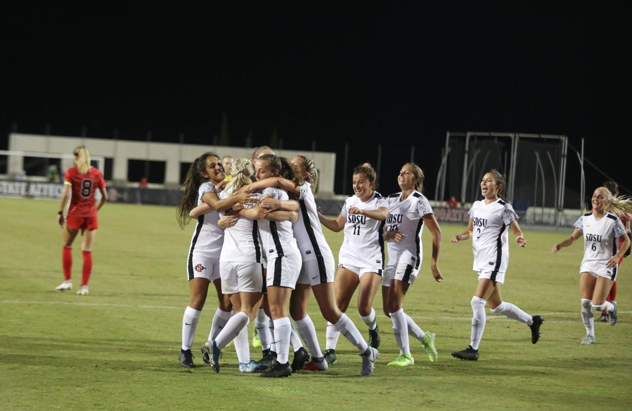 San Diego State women's soccer celebrates a goal by senior forward Darcy Weiser during the Aztecs' 1-0 win over UNLV on Oct. 4 at the SDSU Sports Deck.