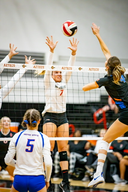 Senior outside hitter Hannah Turnlund attempts to block the ball in the Aztecs' 3-2 loss to Boise State on Oct. 24 at Peterson Gym.