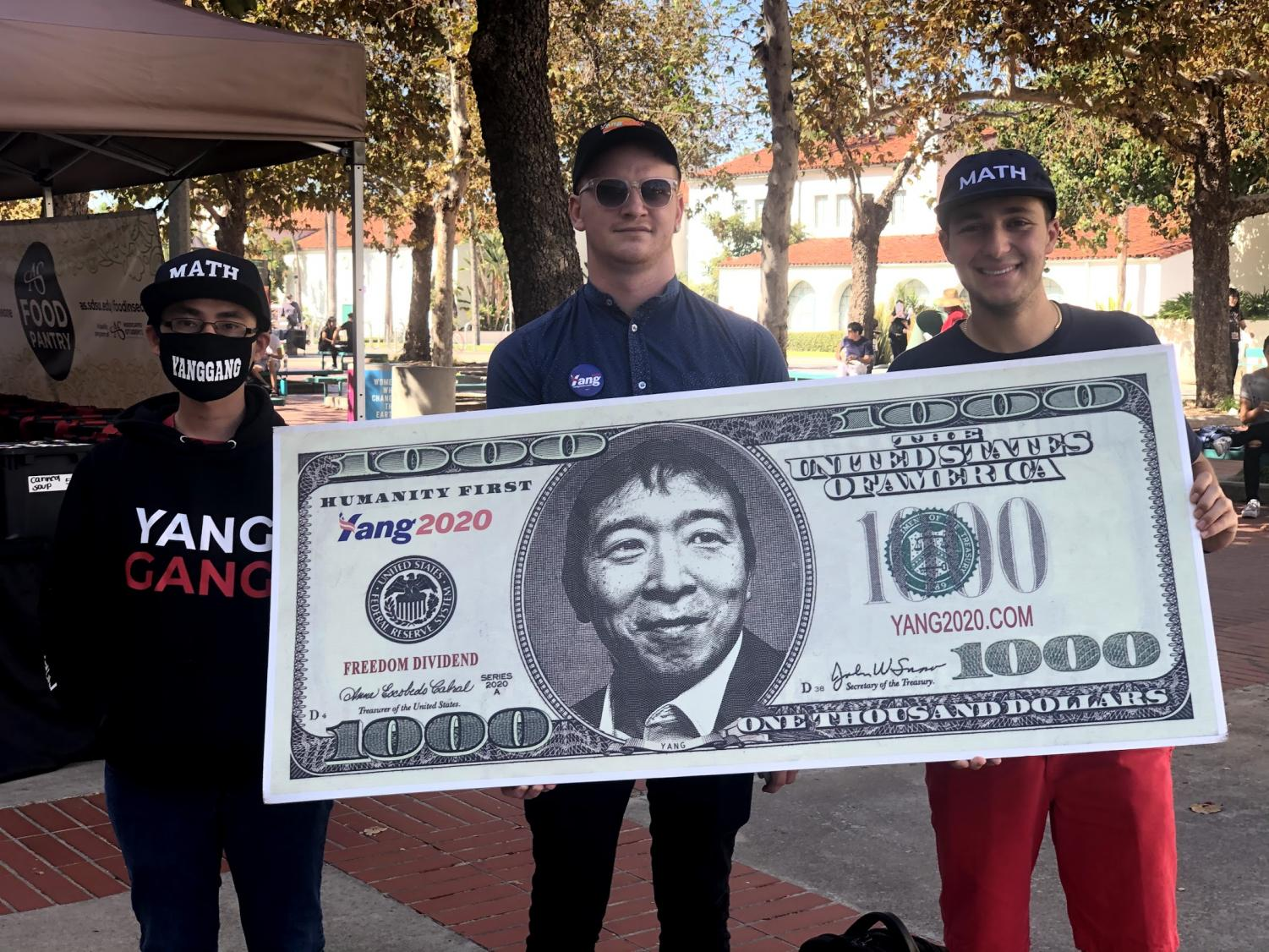 Student organizers canvass outside Love Library for Andrew Yang (D).