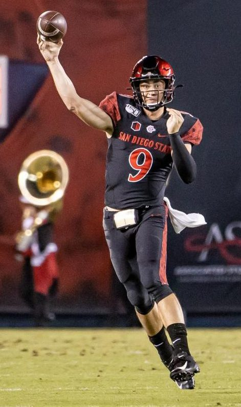 Senior quarterback Ryan Agnew throws on the run during the Aztecs' 26-22 victory over Wyoming on Oct. 12 at SDCCU Stadium. Agnew finished the game with 209 yards and two touchdowns on 21 of 32 passing.