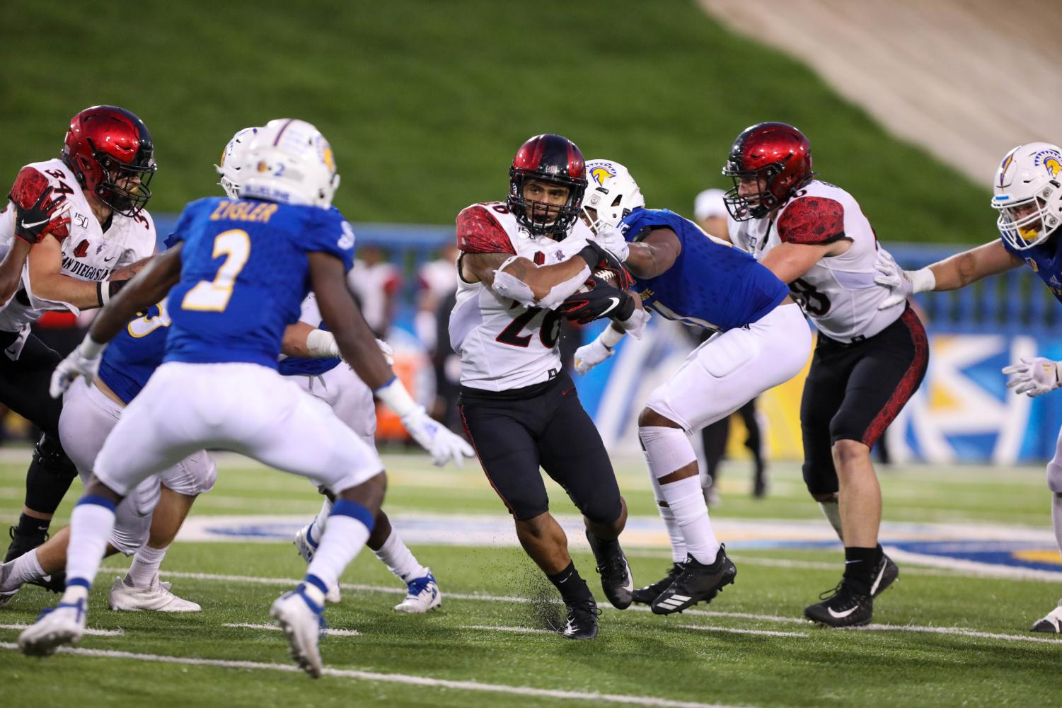 Sophomore running back Kaegun Williams runs through the Spartan defense during the Aztecs' 27-17 victory over San José State on Oct. 19 at CEFCU Stadium. Williams returned the opening kickoff for a 95-yard touchdown.