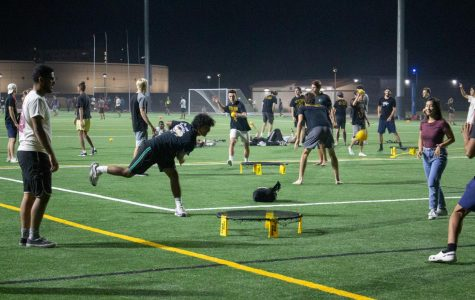 Students spike balls instead of drinks on the new turf field