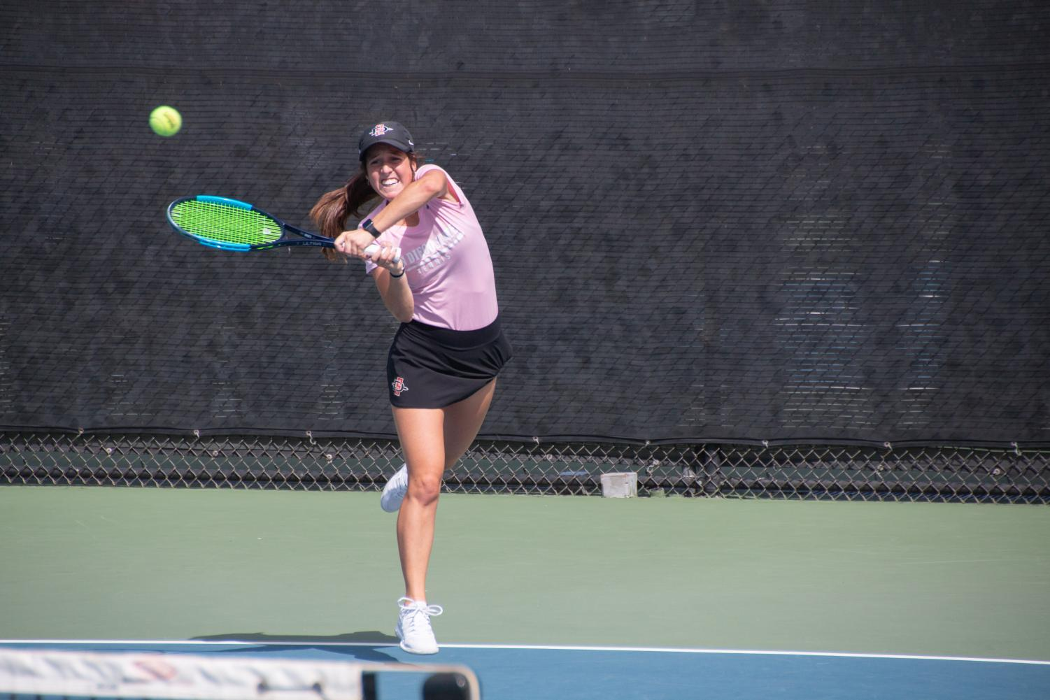 Junior Abbie Mulbarger swings at the ball during the SDSU Fall Classic I on Sept. 29 at Aztec Tennis Center.