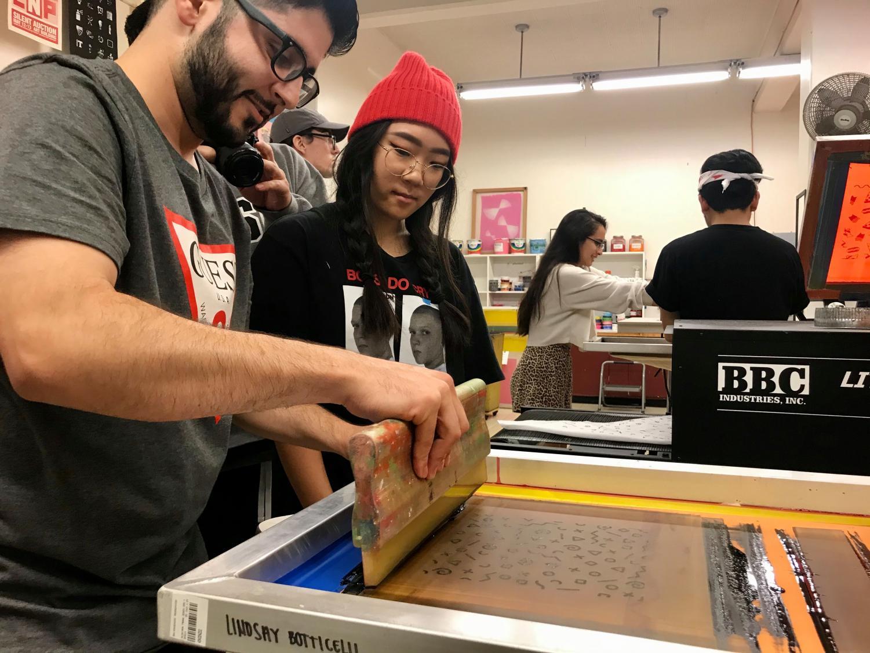 Students used printing presses to make designs on totes, shirts and bandanas.