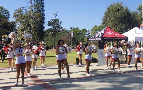 SDSU's cheer team and the school band perform on Campanile walkway.
