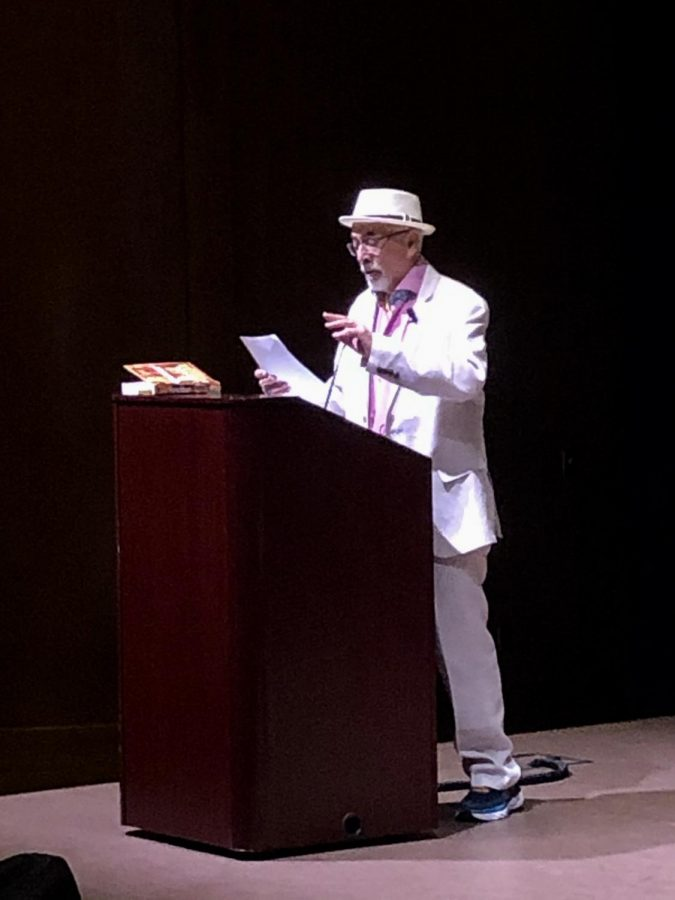 "Herrera reciting his poem ""How To Make World Unity Salsa."""