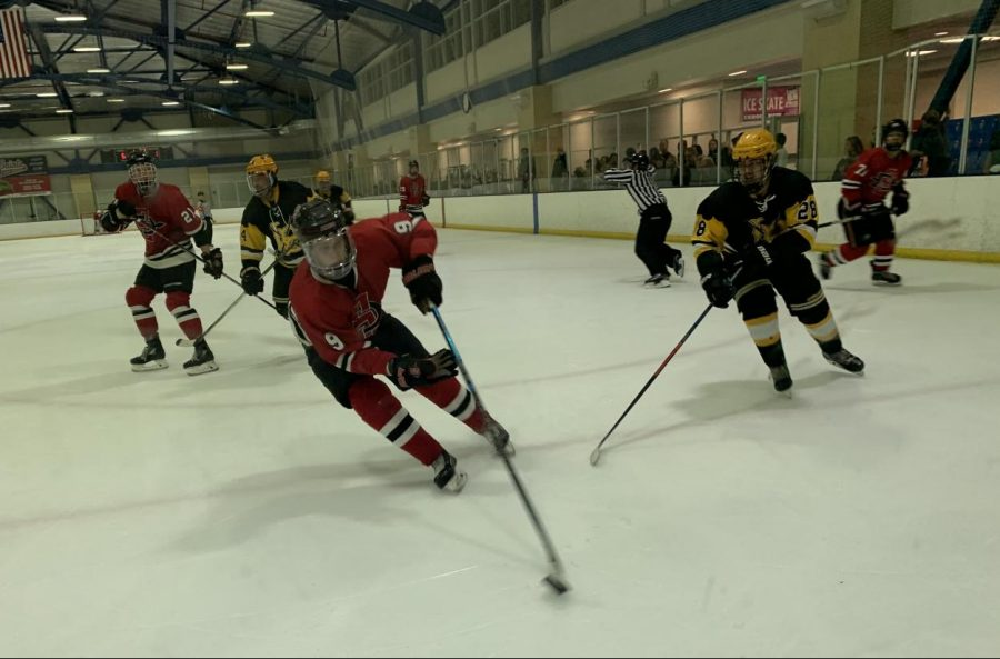 Senior+forward+Aaron+Mayer+controls+the+puck+during+the+Aztecs%27+8-1+win+over+Long+Beach+State+on+Nov.+23+at+the+Joan+Kroc+Center.+