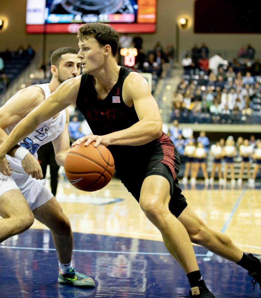Graduate senior forward Yanni Wetzell drives to the basket in the Aztecs' 66-49 win over the University of San Diego on Nov. 20 at Jenny Craig Pavilion. Wetzell finished the game with a career-high 20 points and 12 rebounds.