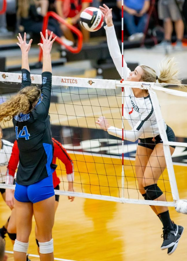 Senior outside hitter Hannah Turnlund goes for a kill during the Aztecs' 3-1 win over Air Force on Nov. 14 at Peterson Gym.